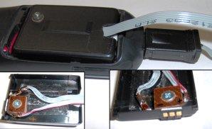 Detail napájení mobilu, starou baterii jsem vykuchal a na její kontakty přivedl napájení z alarmu. Kontakty jsou přilepeny a zajištěny šroubkem